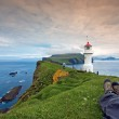 Resting after hiking at Mykines Lighthouse, Faroe Islands — Stock Photo #38758749