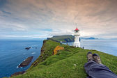 Resting after hiking at Mykines Lighthouse, Faroe Islands — Stock Photo