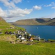 Stock Photo: Remote small village surrounded by nature of Faroe Islands