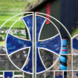 Stained glass celtic cross on a gate — Stock Photo