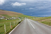Road running through green fields of Faroe Islands — Stock Photo