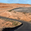 Winding road in a barren landscape — Stock Photo