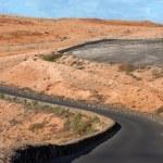 Winding road in a barren landscape — Stock Photo