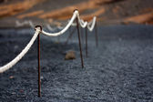 Lanzarote, detail of boundary rope in volcanic beach — Stock Photo