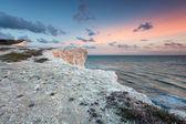 Pastel sunset over white sea cliffs — Stock Photo