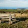 Foto Stock: Empty wooden bench facing english countryside