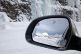 Driving in snow, reflection on the wing mirror — Stock Photo