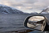 Driving along a fjord in winter Norway — 图库照片