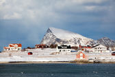 Scattered houses on a snowy island over arctic circle — Stock Photo