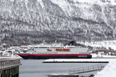 Hurtigruten ship entering Tromso harbour — Stock Photo