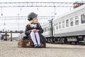 Girl at the train station — Stock Photo