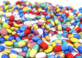Pills and capsules placed on a table, DOF — Stock Photo