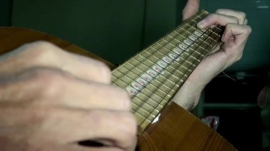 Playing guitar chords hand string — Stock Video