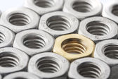 Golden screw nut — Stock Photo