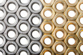 Golden and silver screw nuts — Stock Photo