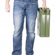 Man carries jerrycan. — Stock Photo
