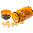 Pills spilling out of apothecary bottle — Stock Photo