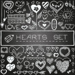 Hand drawn set of hearts and arrows with chalkboard effect. — Stock Vector #50573361