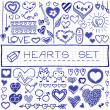 Hand drawn set of hearts and arrows, blue pen effect. — Stock Vector #50573735