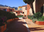 Porto Cervo red houses — Stock Photo