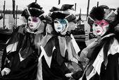 Venetian masks and Godola boats in Venice — Stock Photo