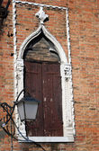 Old venetian window and street lamp — Foto de Stock