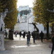 Stock Video: Tourists walk along alleys of park in Mirabell Palace, Salzburg