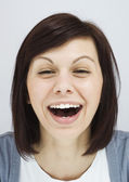 Young girl laughing sincerely — Stock Photo
