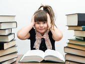 Pretty little girl with books — Stock Photo