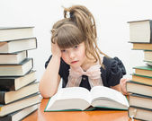 Little tired girl with books — Foto Stock