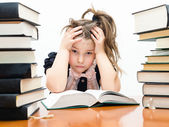 Little tired girl with books — Stock Photo