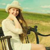 Beautiful cheerful girl has a rest in the summer on the nature — Stock Photo