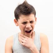 Teenager suffers pain — Stock Photo