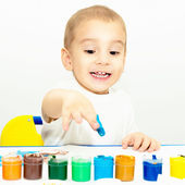 Little boy draws fingers with paint — Stock Photo
