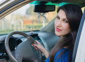 A beautiful young woman driving a car — Stock Photo