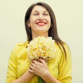 Beautiful girl with a bouquet of flowers — Stock Photo