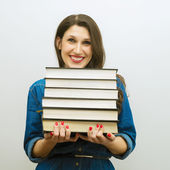 Attractive cheerful woman with books — Stock Photo