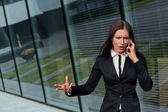 Beautiful business woman bossy on the phone — Stock Photo