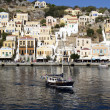 Little boat in a Symi bay — Stock Photo