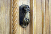 Ancient hand doorknocker from copper — Stock Photo