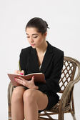 Business woman writing in a notebook — Foto de Stock