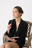 Business woman with a notebook and pencil in hand — Stock Photo