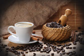Coffee cup cinnamon coffee beans — Stock Photo