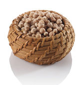 Chickpeas in a wicker basket — Stock Photo