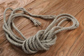 Ropes on a wooden background — Stock Photo