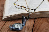 Old book vintage watches glasses — Stock Photo
