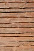 Houten bord met knopen en scheuren — Stockfoto
