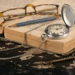 Vintage pocket watch old book and pencil Brass Key — Stock Photo