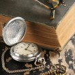 Vintage pocket watch old book and Brass Key — Stock Photo