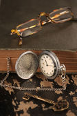 Intage pocket watch old book and Brass Key — Stock Photo